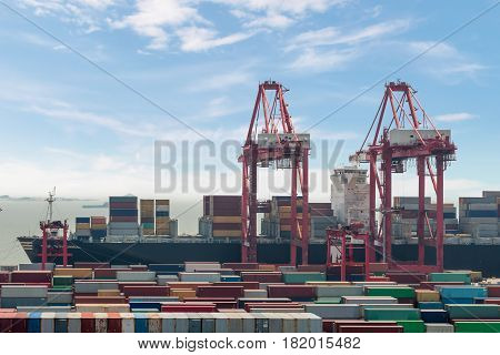 Industrial port with containers Shanghai Yangshan deepwater port is a deep water port for container ships in Hangzhou Bay south of Shanghai China.