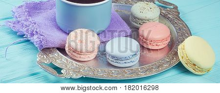 Banner of sweet colorful cookies macaroons on silver vintage salver