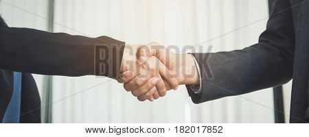 Negotiating businessImage businesswomen handshake happy with workbusiness woman she is enjoying with her workmate. Handshake Gesturing People Connection Deal Concept.