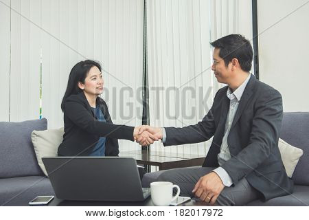 Negotiating businessImage businesswomen handshakehappy with workbusiness woman she is enjoying with her workmateHandshake Gesturing People Connection Deal Concept.