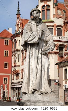 MARIBOR, SLOVENIA - APRIL 03: Saint Anthony of Padua statue, Plague column at Main Square of the city of Maribor in Slovenia, Europe. Historical religious sculpture, April 03, 2016.