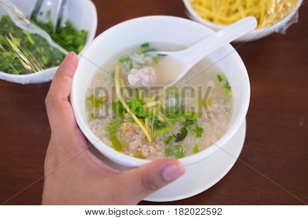 rice porridge minced pork in bowl on wood table