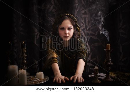 the young witch on black background  indoor