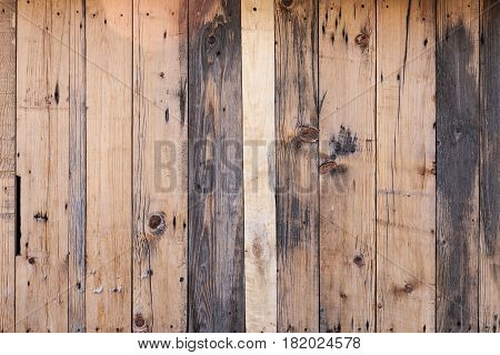 The brown wood plank wall texture background