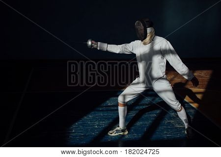 The Fencer Prepares For Competitions. Fencing Coach. Fencing Sport Motivation. Mask And Sword