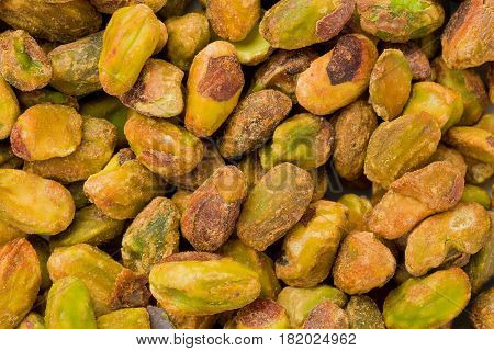 Background texture of shelled and roasted pistachios.
