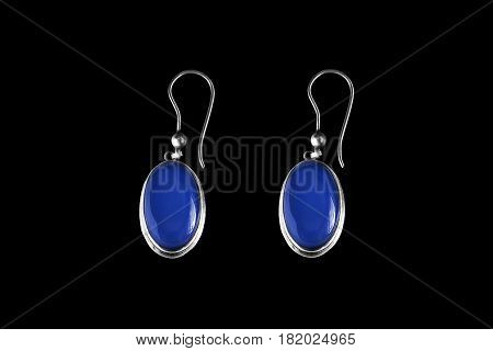 Vintage sapphire earrings isolated on black background