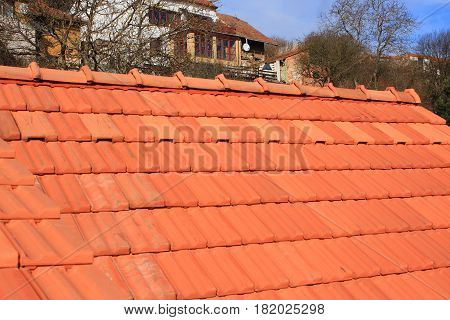 The new roof is covered with red burnt roof tiles