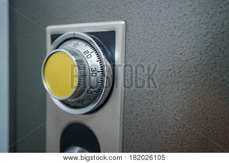 Closeup of combination safe with yellow knob