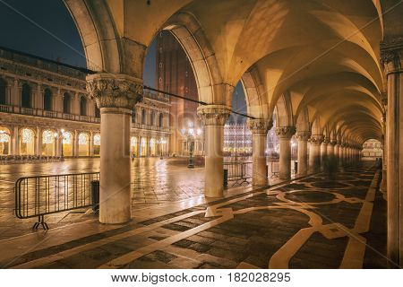 NIGHT VENICE, ITALY, Palazzo Ducale's arcade, ancient doges palace, in the famous San Marco's square, in Venice.