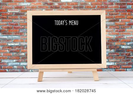 Today's menu on blank chalk board over brick wall background food and drinks list background