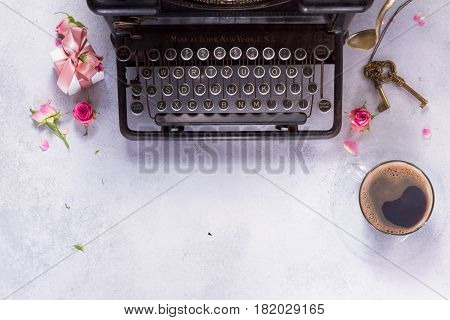 Workspace scene frame with vintage typewriter, coffee and keys