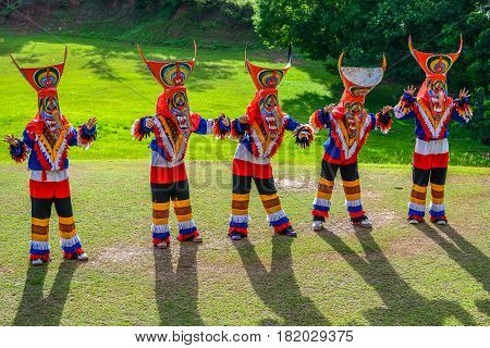 Kid dancers with ghost masks made from bamboo to show in Thai northeastern traditional Phi Ta Khon ghost Festival