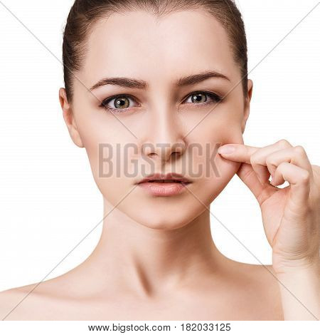 Young woman pulls cheek's skin. Elasticity skin concept.