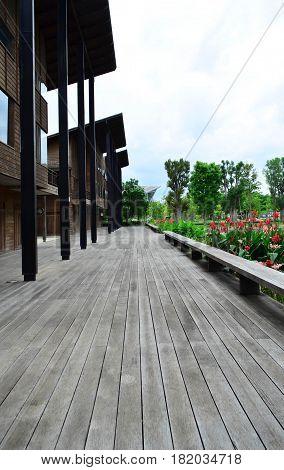 Wooden walk way in front of wooden building