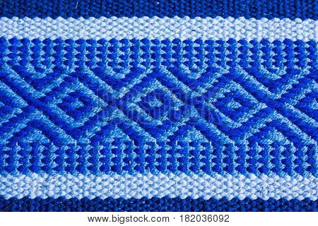 Blue Carpet Texture, Background. Blue artificial fabric texture. Close-up of abstract fabric texture as background for interior design. Upholstery fabric for upholstered furniture.