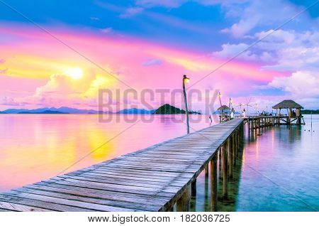 Dramatic sunset sky on tropical beach in summer season Scenery sea and island at Koh Mak Island TradThailand - Vacations And Tourism Concept.