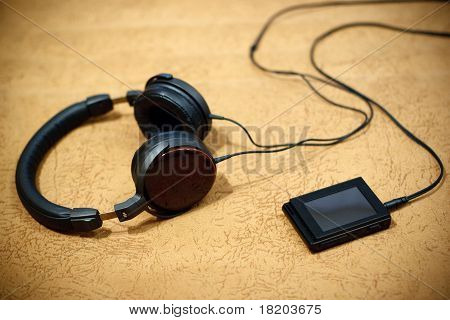 Headphones And Player On A Light-brown Background
