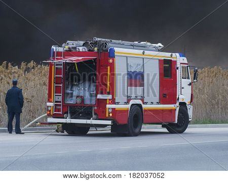 A man and a fire truck near the road