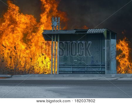 The bus stop and fire hugebehind it