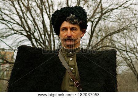Volgograd Russia - November 21 2010: Portrait of actor dressed as cossack of World War II in military-historical reconstruction in Volgograd.