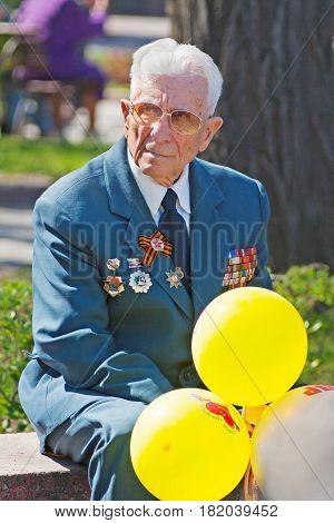 Volgograd Russia - May 01 2009: Portrait of World War II veteran with balloons in Volgograd