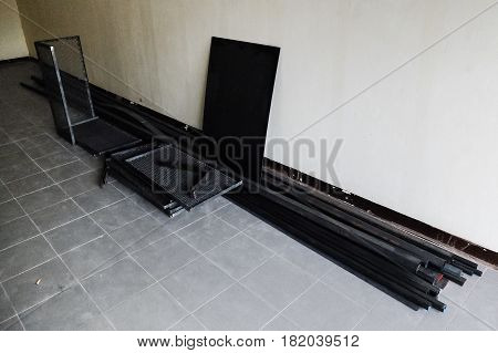 Expanded Metal And Steel Rod On The Floor