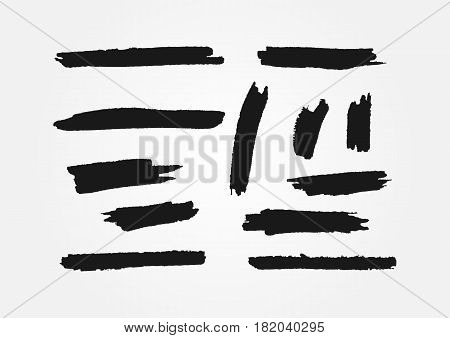 Set of twelve isolated smears. Ragged brushstrokes painted brushes. Black lines and spots. Grunge. Vector illustration.