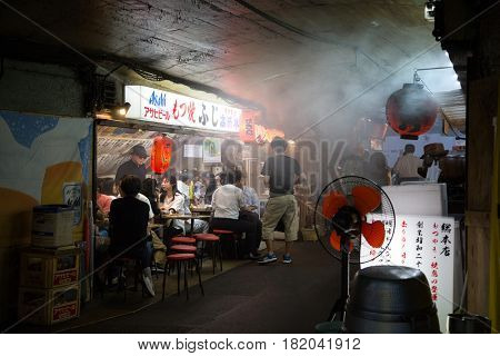 Tokyo, Japan - 21 June 2016: The backstreet cafes and bars of Shinbashi. These street cafes are frequented mainly by locals, and are a glimpse of traditional culture away from the tourist trail.