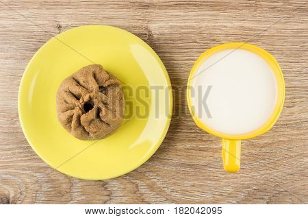 Pie Stuffed From Unleavened Dough In Saucer And Milk