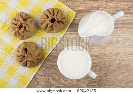Pies Stuffed From Unleavened Dough On Checkered Napkin, Milk