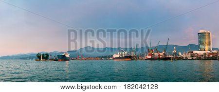 Batumi, Adjara, Georgia. Port Dock On Sunny Evening At Sunset Or Sunrise Time. Sunny Landscape Of Local Port With Moored Tanker Vessel Ship