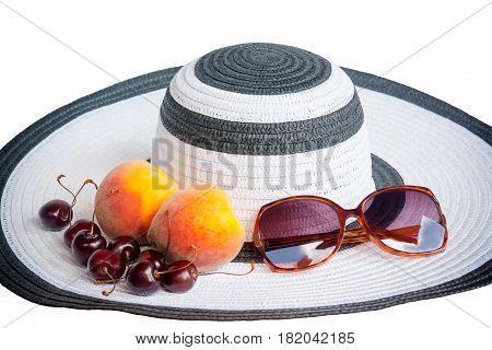 Large beach hat fruits and glasses from the sun isolated on white background