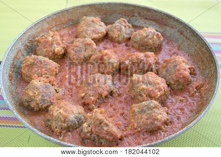beef meatballs served in a rich tomato sauce and cooked in pan