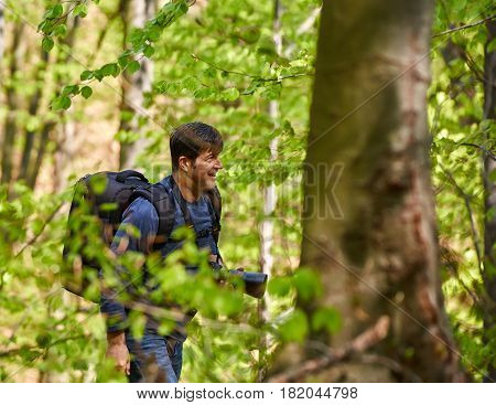 Male Tourist With Backpack In The Forest