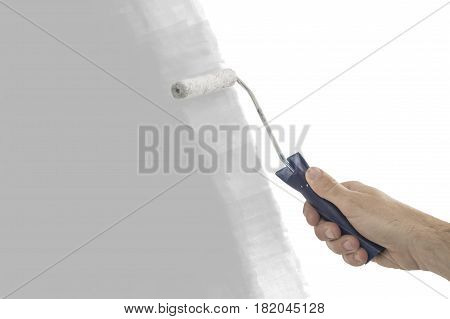 House painter using a paint roller painting a wall in motion.