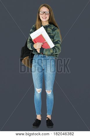 Teenage girl student smiling and holding textbook