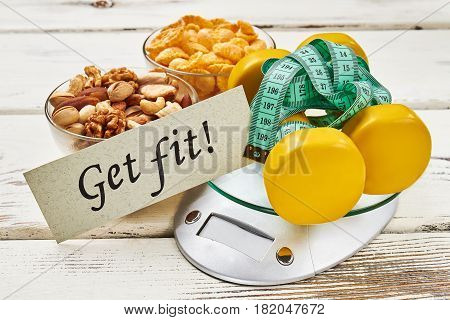 Kitchen scales, dumbbells and nuts. Ready to get fit.