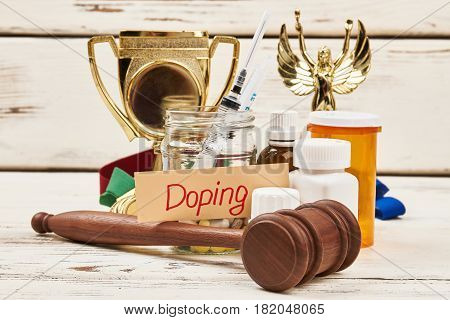 Cup, pills and hammer. Criminal punishment for doping.