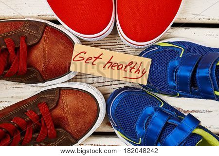Sport shoes and motivation card. Healthier you from today.