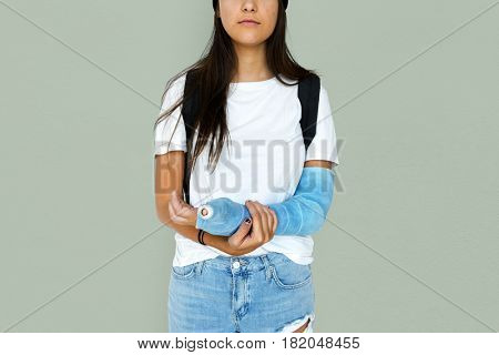 Young Adult Woman with Broken Arm Studio Portrait