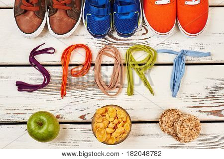 Crispbread, apple, gumshoes and shoelaces. Healthy for life.