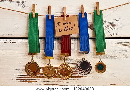 Medals on clothesline. I can do this.