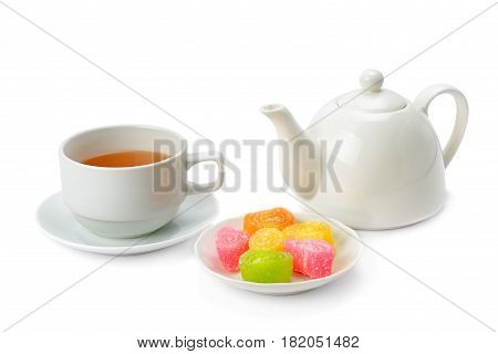 Teapot tea in a cup and jujube isolated on white background.