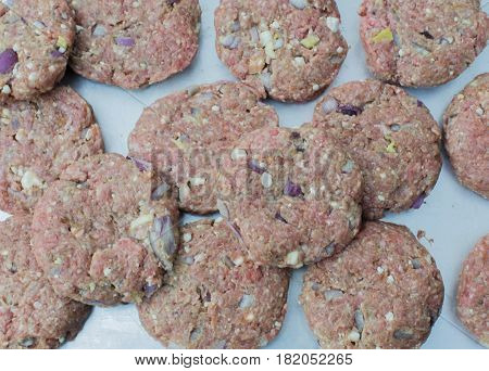 Prepared mincemeat for grilling hamburger on a plate