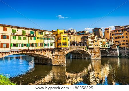 Famous Ponte Vecchio With River Arno At Sunset In Florence, Italy