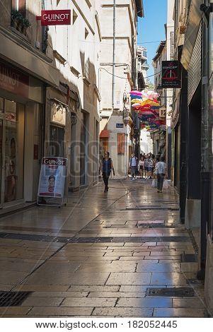 Avignon, France - September 9, 2016: Umbrella street in the historic center of Avignon in France