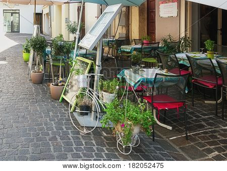 Avignon, France - September 9, 2016: Restaurant with as eyecatcher a decorative bicycle as plant holder in the historic center of Avignon in France