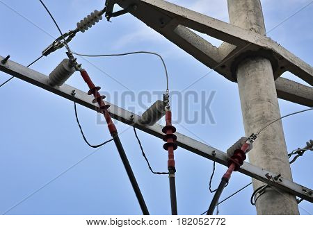 Closeup of concrete electric pylon with three isolated phases