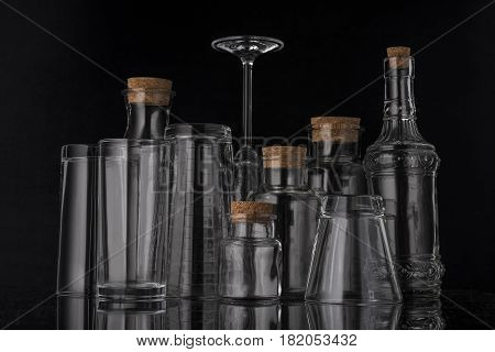 Glass, transparent glassware with beautiful white highlights on a black background.